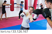 Sportswomen competing in colored boxing gloves. Стоковое фото, фотограф Яков Филимонов / Фотобанк Лори
