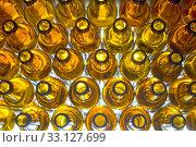 Купить «Yellow glass empty beer bottles, top view», фото № 33127699, снято 5 мая 2019 г. (c) Куликов Константин / Фотобанк Лори