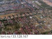Купить «Imobilien am rande der Stadt Bangkok in Thailand in Suedostasien.», фото № 33128167, снято 10 июля 2020 г. (c) PantherMedia / Фотобанк Лори
