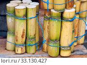 Купить «A close up photo of a stack of sugar cane sticks», фото № 33130427, снято 8 апреля 2020 г. (c) PantherMedia / Фотобанк Лори