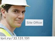 Купить «Portrait Of Construction Worker At Site Office», фото № 33131191, снято 28 мая 2020 г. (c) PantherMedia / Фотобанк Лори