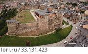 Купить «Aerial panoramic view of small Spanish city of Ponferrada overlooking ancient Templar castle», видеоролик № 33131423, снято 19 июня 2019 г. (c) Яков Филимонов / Фотобанк Лори