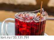 Купить «Spanish sangria with fruit and ice, outdoor, street cafe», фото № 33131791, снято 7 февраля 2015 г. (c) Gagara / Фотобанк Лори
