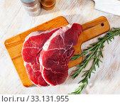 Купить «Raw beef fillet with rosemary», фото № 33131955, снято 31 мая 2020 г. (c) Яков Филимонов / Фотобанк Лори