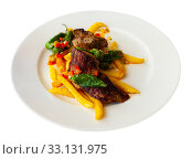 Купить «Tasty roasted beef with vegetable stew on plate», фото № 33131975, снято 5 июля 2020 г. (c) Яков Филимонов / Фотобанк Лори