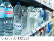 Купить «Barcelona, Spain - November 7, 2019: Drinking water bottles on store shelves», фото № 33132283, снято 7 ноября 2019 г. (c) Яков Филимонов / Фотобанк Лори