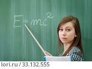 Купить «Student girl showing e=mc2 formula», фото № 33132555, снято 28 мая 2020 г. (c) PantherMedia / Фотобанк Лори