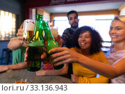Купить «Friends having fun together while drinking», фото № 33136943, снято 15 ноября 2019 г. (c) Wavebreak Media / Фотобанк Лори