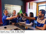 Купить «Supporters having fun together while drinking», фото № 33136947, снято 15 ноября 2019 г. (c) Wavebreak Media / Фотобанк Лори