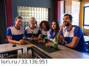 Купить «Supporters looking at the match on TV together», фото № 33136951, снято 15 ноября 2019 г. (c) Wavebreak Media / Фотобанк Лори