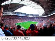 Купить «LONDON - APRIL 14 : Supporters watch the football game of Liverpool - Everton Semi Final FA Cup Crowd at Wembley Arena Staduim on April 14, 2012 in London, England United Kingdom.», фото № 33145823, снято 14 апреля 2012 г. (c) age Fotostock / Фотобанк Лори