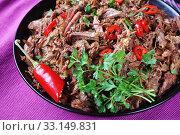 Купить «close-up of spicy slow cooked pulled beef», фото № 33149831, снято 5 ноября 2019 г. (c) Oksana Zh / Фотобанк Лори
