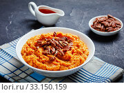 Купить «sweet potato mash topped with pecan nuts», фото № 33150159, снято 21 ноября 2019 г. (c) Oksana Zh / Фотобанк Лори