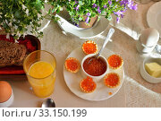 Festive continental breakfast with red caviar, soft-boiled egg and orange juice. Стоковое фото, фотограф Raykin Dmitriy / PantherMedia / Фотобанк Лори