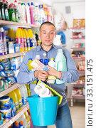 Купить «Male customer holding household chemistry with shopping list», фото № 33151475, снято 4 июня 2018 г. (c) Яков Филимонов / Фотобанк Лори