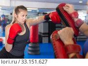 Купить «man is training with woman and punching gloves in box gym.», фото № 33151627, снято 21 августа 2017 г. (c) Яков Филимонов / Фотобанк Лори