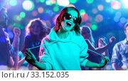Купить «woman in hoodie and sunglasses at nightclub», фото № 33152035, снято 30 сентября 2019 г. (c) Syda Productions / Фотобанк Лори
