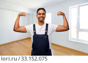 Купить «indian builder showing his power at new home», фото № 33152075, снято 17 ноября 2019 г. (c) Syda Productions / Фотобанк Лори