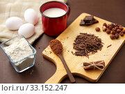 Купить «chocolate, cocoa powder, milk, eggs and flour», фото № 33152247, снято 1 февраля 2019 г. (c) Syda Productions / Фотобанк Лори