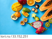 different exotic fruits on blue background. Стоковое фото, фотограф Syda Productions / Фотобанк Лори