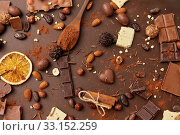 Купить «cocoa beans, chocolate, nuts and cinnamon sticks», фото № 33152259, снято 1 февраля 2019 г. (c) Syda Productions / Фотобанк Лори