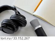 Купить «headphones, microphone and notebook with pencil», фото № 33152267, снято 17 мая 2019 г. (c) Syda Productions / Фотобанк Лори