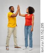 Купить «happy african american couple making high five», фото № 33152295, снято 15 декабря 2019 г. (c) Syda Productions / Фотобанк Лори