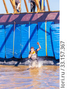 Купить «Young athlete participant in a race of heroes jumps from a bungee from a great height into the water», фото № 33157367, снято 8 июня 2019 г. (c) Акиньшин Владимир / Фотобанк Лори
