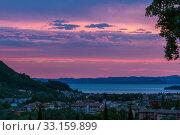 sunset over the lake Garda. Стоковое фото, фотограф Volodymyr Melnyk / PantherMedia / Фотобанк Лори