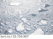 Купить «Water drops are on a white plastic fabric. Close-up», фото № 33159907, снято 5 января 2020 г. (c) EugeneSergeev / Фотобанк Лори