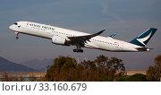 Купить «Airbus of Cathay Pacific Airways soaring from El Prat Airport», фото № 33160679, снято 2 февраля 2020 г. (c) Яков Филимонов / Фотобанк Лори