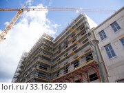Купить «facade with scaffolding», фото № 33162259, снято 8 апреля 2020 г. (c) PantherMedia / Фотобанк Лори