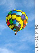 Купить «Hot air balloon over blue sky», фото № 33164843, снято 29 февраля 2020 г. (c) PantherMedia / Фотобанк Лори