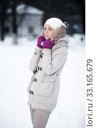 Купить «Attractive young woman in wintertime outdoor», фото № 33165679, снято 6 августа 2020 г. (c) PantherMedia / Фотобанк Лори
