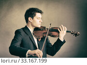 Купить «man violinist playing violin. classical music art», фото № 33167199, снято 21 февраля 2020 г. (c) PantherMedia / Фотобанк Лори