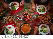 High angle view of festive table and people eating. Стоковое фото, фотограф Dmitriy Shironosov / PantherMedia / Фотобанк Лори