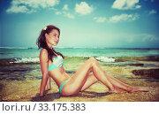 Купить «Beautiful model on the beach», фото № 33175383, снято 28 февраля 2020 г. (c) PantherMedia / Фотобанк Лори