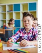 Schoolboy at lesson. Стоковое фото, фотограф Dmitriy Shironosov / PantherMedia / Фотобанк Лори