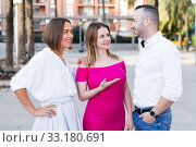 Купить «Stranger man is talking with young females who are resting», фото № 33180691, снято 18 октября 2017 г. (c) Яков Филимонов / Фотобанк Лори
