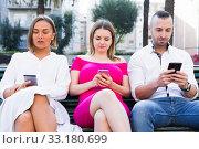 Купить «Young people are focusing on smartphones during a together walking», фото № 33180699, снято 18 октября 2017 г. (c) Яков Филимонов / Фотобанк Лори