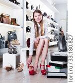 Купить «Woman is trying summer shoes in shoes store», фото № 33180827, снято 13 декабря 2017 г. (c) Яков Филимонов / Фотобанк Лори