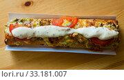 Купить «Polish zapiekanka toasted baguette with cheese and vegetables», фото № 33181007, снято 12 мая 2018 г. (c) Яков Филимонов / Фотобанк Лори