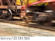 Купить «wheelset of a railway car rushes along the rails with great speed blur.», фото № 33181563, снято 29 сентября 2019 г. (c) Акиньшин Владимир / Фотобанк Лори