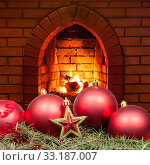 red star and Xmas bubles and home fireplace. Стоковое фото, фотограф Valery Vvoennyy / PantherMedia / Фотобанк Лори