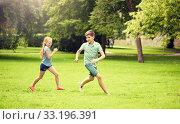 Купить «happy kids running and playing game outdoors», фото № 33196391, снято 24 июля 2016 г. (c) Syda Productions / Фотобанк Лори