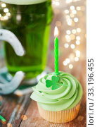 green cupcake with candle, beer and horseshoe. Стоковое фото, фотограф Syda Productions / Фотобанк Лори