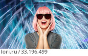 Купить «happy woman in pink wig and black sunglasses», фото № 33196499, снято 30 сентября 2019 г. (c) Syda Productions / Фотобанк Лори