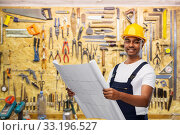 Купить «happy indian builder in helmet with blueprint», фото № 33196527, снято 17 ноября 2019 г. (c) Syda Productions / Фотобанк Лори