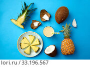 pineapple, coconut and drink with paper straw. Стоковое фото, фотограф Syda Productions / Фотобанк Лори