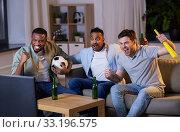 Купить «friends with ball and vuvuzela watching soccer», фото № 33196575, снято 28 декабря 2019 г. (c) Syda Productions / Фотобанк Лори